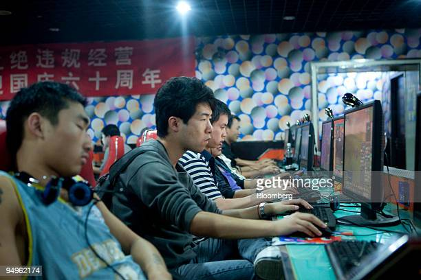 Customers at an internet cafe play online games in Beijing China on Friday Sept 25 2009 Shanda Games Ltd a seller of multiplayer online video games...