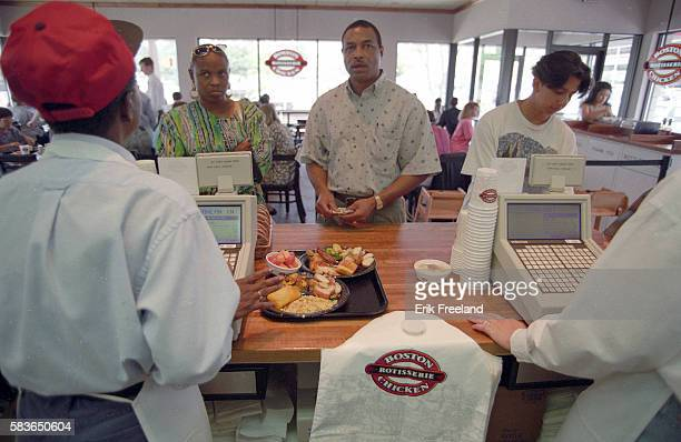 Customers at Boston Chicken purchasing lunch