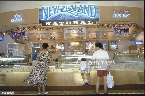 Customers at counter of New Zealand Ice Cream store
