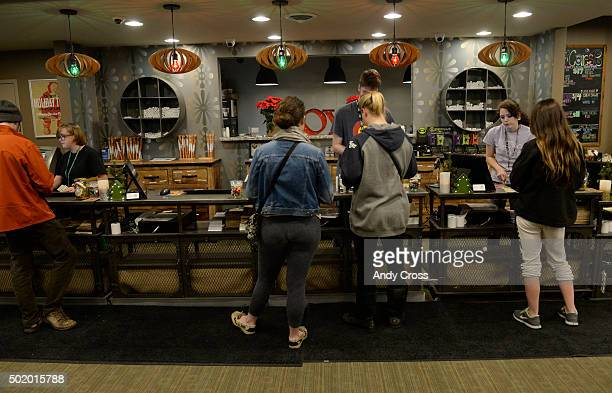 Customers at Emerald Fields retail marijuana shop at the customer counter December 09 2015 Photo by Andy Cross/The Denver Post via Getty Images