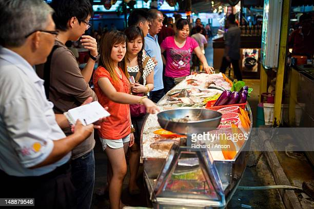 Customers at Seafood stall at Red Garden Food Paradise and Night Market.