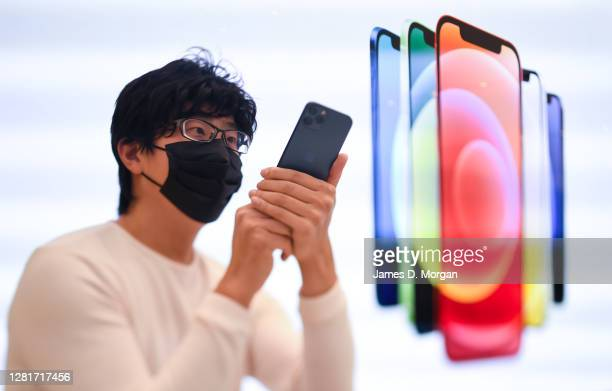 Customers at the Apple Store in George Street look at the new iPhone 12 on sale on October 23, 2020 in Sydney, Australia. The iPhone 12 features the...