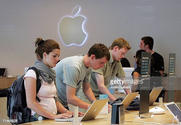 Customers at the Apple Store try out MacBook Pro laptop computers July 19 2006 in San Francisco California Apple Computer Inc announced that third...