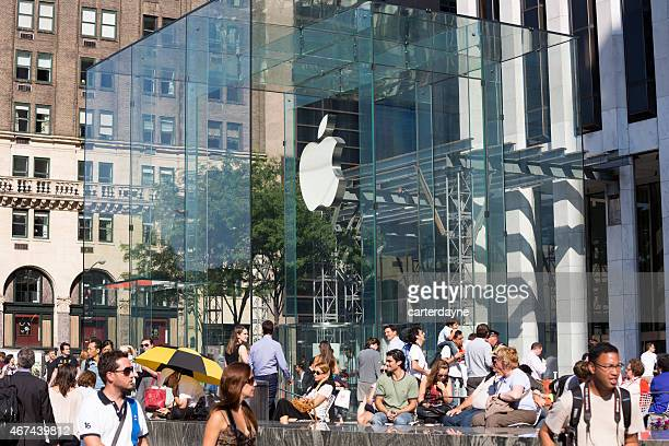 customers at the flagship apple store new york city - flagship store stock pictures, royalty-free photos & images