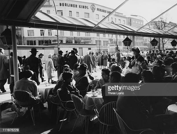 Customers at the Konditorei Kranzler a patisserie on the Kurfurstendamm in west Berlin circa 1955