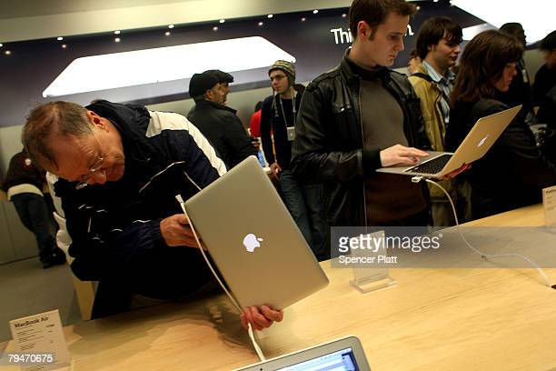 Customers at the midtown fifth avenue Apple Store look at the new MacBook Air on sale beginning today February 1 2008 in New York City The Macbook...