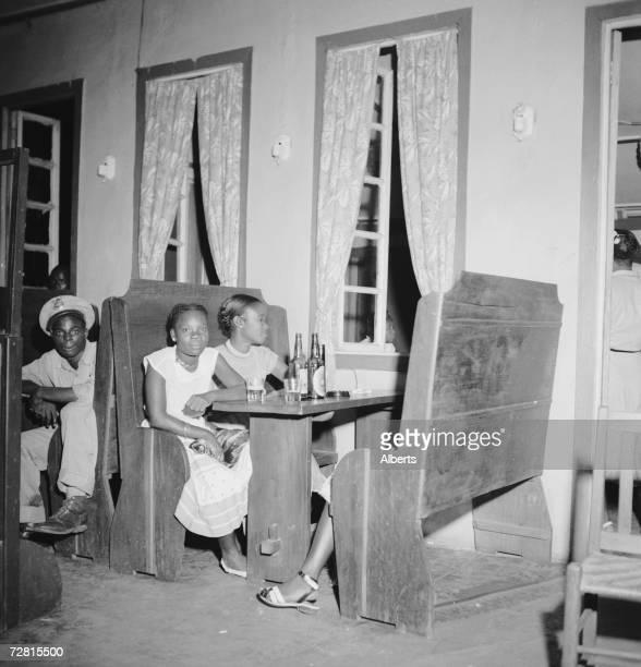 Customers at the Yarngo Bar in Monrovia, Liberia, 1947.
