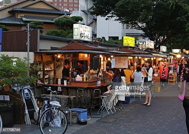 Customers at Yatai Food Stalls in Fukuoka, Kyushu, Japan