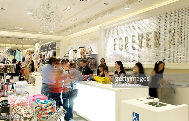 Customers attend the grand opening of the first 'Forever 21' store in Spain at the La Maquinista shopping mall on June 4, 2011 in Barcelona, Spain.