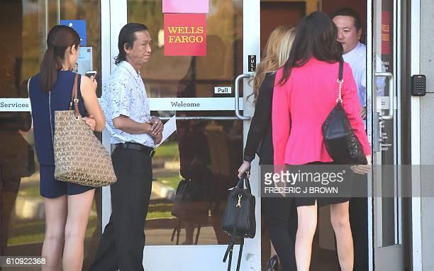 Customers await entry aa a branch of Wells Fargo in Alhambra California opens on September 28 2016 Wells Fargo CEO John Stumpf will forgo $41 million...
