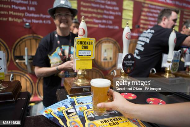 Customers being served different types of beer across Britain at the Great British Beer Festival in Olympia London Keningston London organised by the...