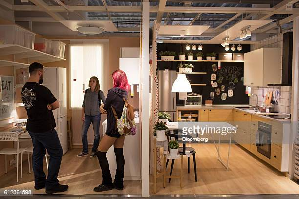 Customers browse a show kitchen inside the Ikea AB retail store in Khimki Russia on Monday Oct 3 2016 Ikea's Russia unit may spend 100 billion rubles...