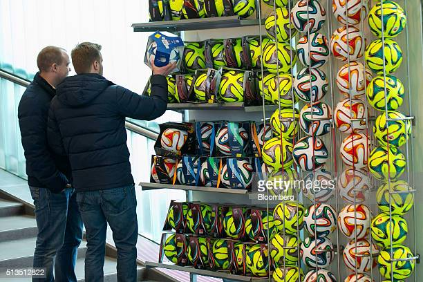 367e1e8a0d Customers browse a soccer ball display inside the Adidas AG store at the company s  headquarters in