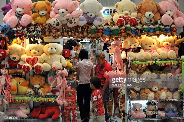 Customers browse at a stuffed toys shop at the Kuala Lumpur International Airport in Sepang on August 2010 Malaysia's economy grew 89 percent...