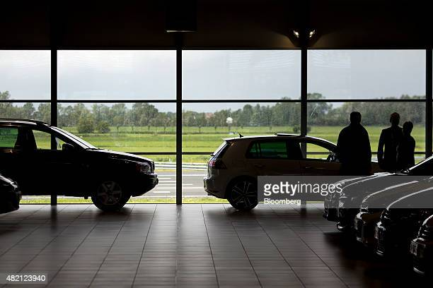 Customers browse automobiles inside a LeasePlan Corp used car leasing and contract hire showroom in Breukelen Netherlands on Monday July 27 2015...
