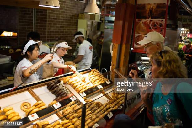 Customers browse bagels at the Granville Island Public Market in Vancouver British Columbia Canada on Sunday June 2 2019 Statistics Canada is...
