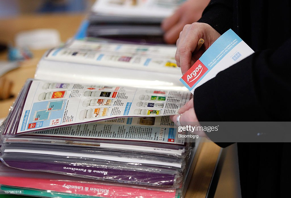 148fd3933e8 Customers browse catalogues at an Argos store, operated by Home ...