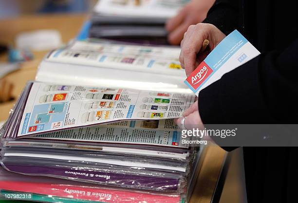 Customers browse catalogues at an Argos store operated by Home Retail Group Plc in London UK on Tuesday Jan 11 2011 UK retail sales fell last month...