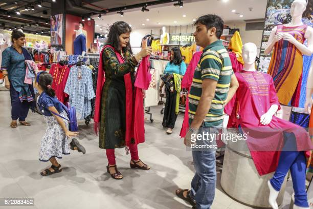 Customers browse clothes at a Big Bazaar hypermarket operated by Future Retail Ltd in Mumbai India on Sunday April 16 2017 Future Retail India's...