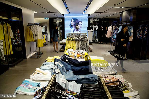 Customers browse clothes at a Zara store operated by Inditex SA in Hong Kong China on Tuesday June 24 2014 Inditex which has increased profit every...