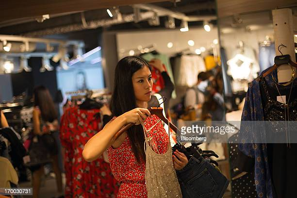 Customers browse clothing during the opening of Arcadia Group Ltd's first Topshop store in Hong Kong China on Thursday June 6 2013 Fashion chain...