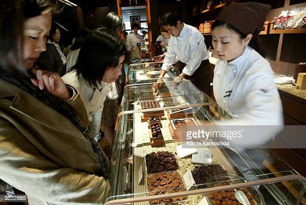 Customers browse confectionary at Pierre Marcolini on April 6 2004 in Tokyo Japan Japanese gourmet chocolates often contain redbeans green tea black...