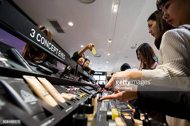 Customers browse cosmetic products at a Hotel Lotte Co Duty Free store in Seoul South Korea on Thursday Feb 4 2016 Hotel Lotte the lodgings and...