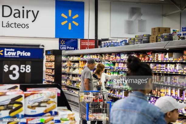 Customers browse dairy products at a Walmart Inc store in Secaucus New Jersey US on Wednesday May 16 2018 Walmart is scheduled to release earnings...