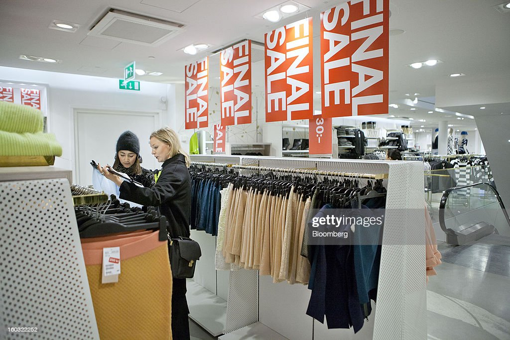 Customers browse discounted garments displayed for sale inside a Hennes & Mauritz AB (H&M) store in Stockholm, Sweden, on Tuesday, Jan. 29, 2013. Hennes & Mauritz AB, Europe's second-largest clothing retailer, reported sales growth that beat analysts' estimates for a second consecutive month as the chain offered markdowns in advance of the Christmas holiday. Photographer: Casper Hedberg/Bloomberg via Getty Images