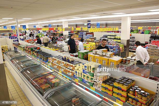 Customers browse displays of merchandise at an Aldi Stores Ltd food store in Sydney Australia on Thursday June 25 2015 Australia's biggest...