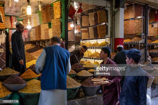 Customers browse dried fruits and nuts at a store at Mandai Bazaar in Kabul Afghanistan on Thursday July 12 2018 US President Donald last year said...