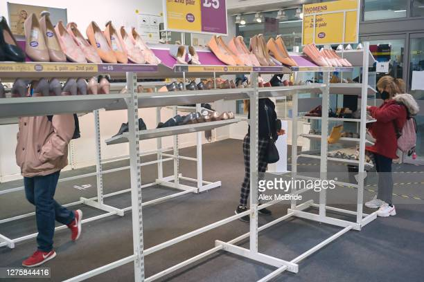 Customers browse for shoes at a closing down sale at Clarks in Elephant & Castle Shopping Centre in Elephant & Castle on September 23, 2020 in...