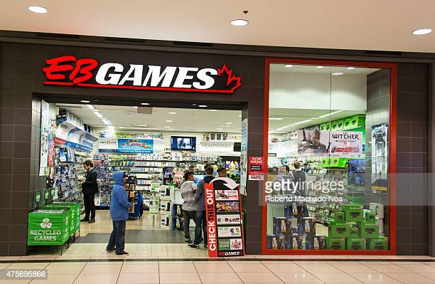 Customers browse games at EB Games in a shopping mall