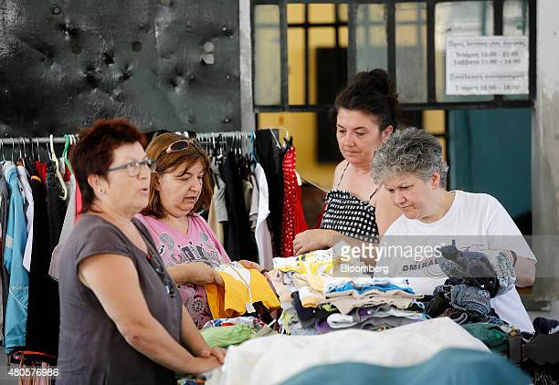 Customers browse goods at an indoor market where an informal barter currency called TEM is used to exchange goods and services in Volos Greece on...
