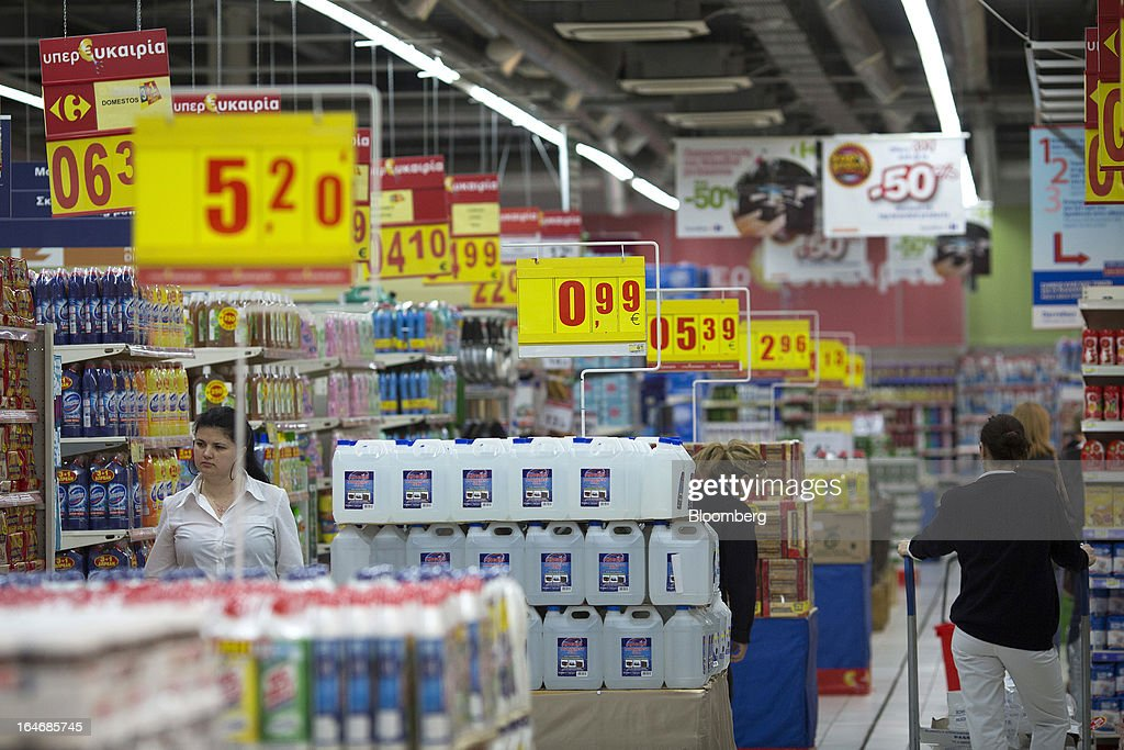 Customers browse goods for sale inside a Carrefour SA supermarket at the Mall of Cyprus in Nicosia, Cyprus, on Tuesday, March 26, 2013. Controls on capital movements to prevent money from draining out of the banking system -- allowed in exceptional circumstances under European Union law -- will remain for 'a matter of weeks,' Cypriot Finance Minister Michael Sarris said. Photographer: Simon Dawson/Bloomberg via Getty Images