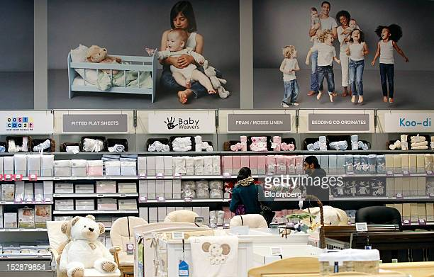 Customers browse goods on display at a Kiddicare Ltd. Store, operated by WM Morrison Supermarkets Plc, in Nottingham, U.K., on Wednesday, Sept. 26,...