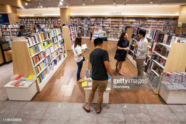Customers browse in the Kinokuniya Co book store at the Aeon Mall in Phnom Penh Cambodia Sunday May 26 2019 Kinokuniya Japan's largest bookstore...