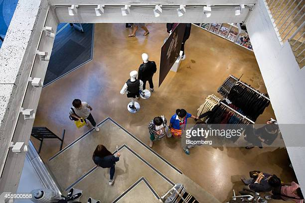 Customers browse inside an 8Seconds fashion store operated by Cheil Industries Inc in Seoul South Korea on Sunday Sept 21 2014 Cheil Industries the...
