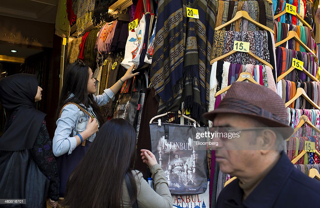 Customers browse Istanbul branded bags for sale at a store on Istiklal street near Taksim Square in Istanbul, Turkey, on Wednesday, April 9, 2014. Turkish central bank Governor Erdem Basci indicated to analysts in London on April 3 that he planned to keep monetary policy tight to control inflation. Photographer: Kerim Okten/Bloomberg via Getty Images