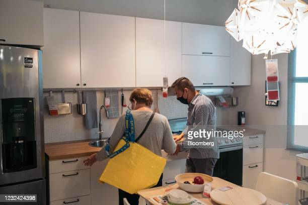Customers browse kitchen furniture in the showroom of an Ikea store in Mexico City, Mexico, on Tuesday, April 20, 2021. The first Ikea store opened...