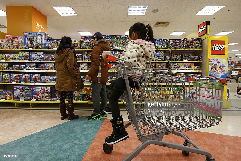 Customers Browse Lego A S Toys As A Girl Sits In A Shopping Cart At News Photo Getty Images