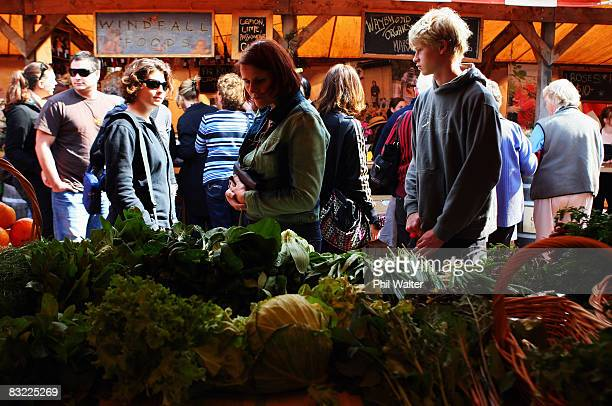 Customers browse locally grown vegatables for sale at the Matakana Famers Market in Matakana October 11 2008 near Auckland New Zealand Farmers...