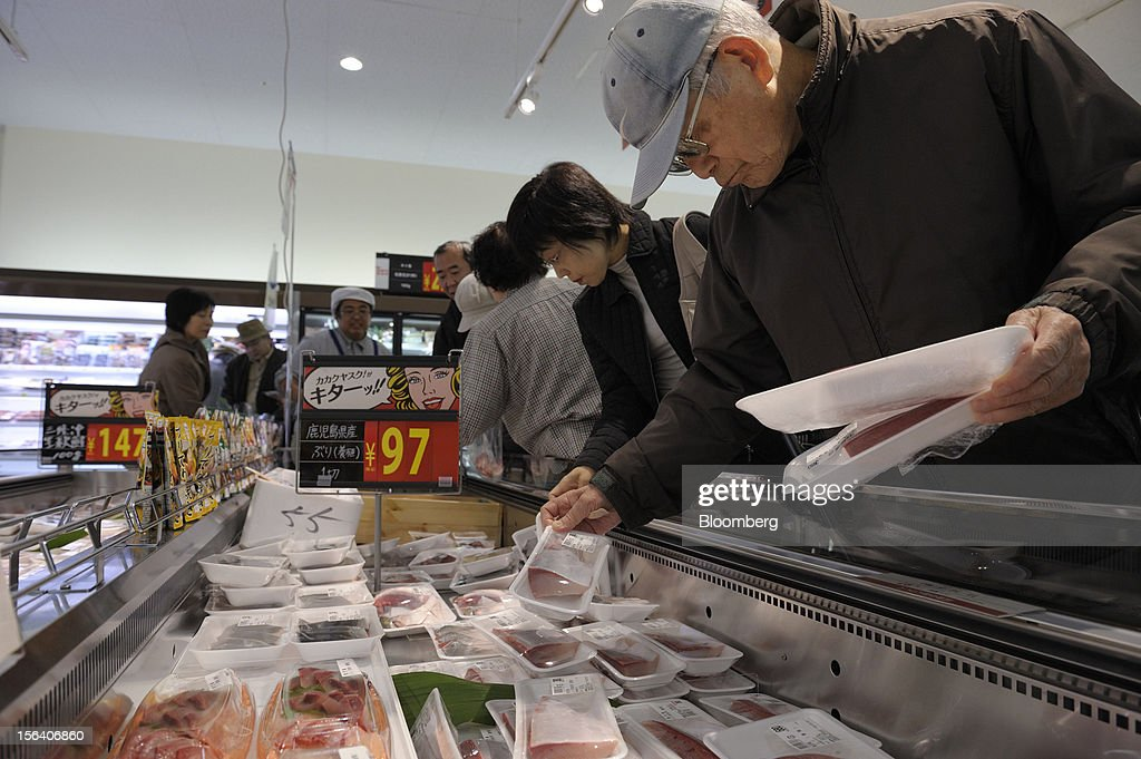 Customers browse packaged fish in a Seiyu GK supermarket in Tokyo, Japan, on Wednesday, Nov. 14, 2012. Seiyu GK is a unit of Wal-Mart Stores Inc. Photographer: Akio Kon/Bloomberg via Getty Images