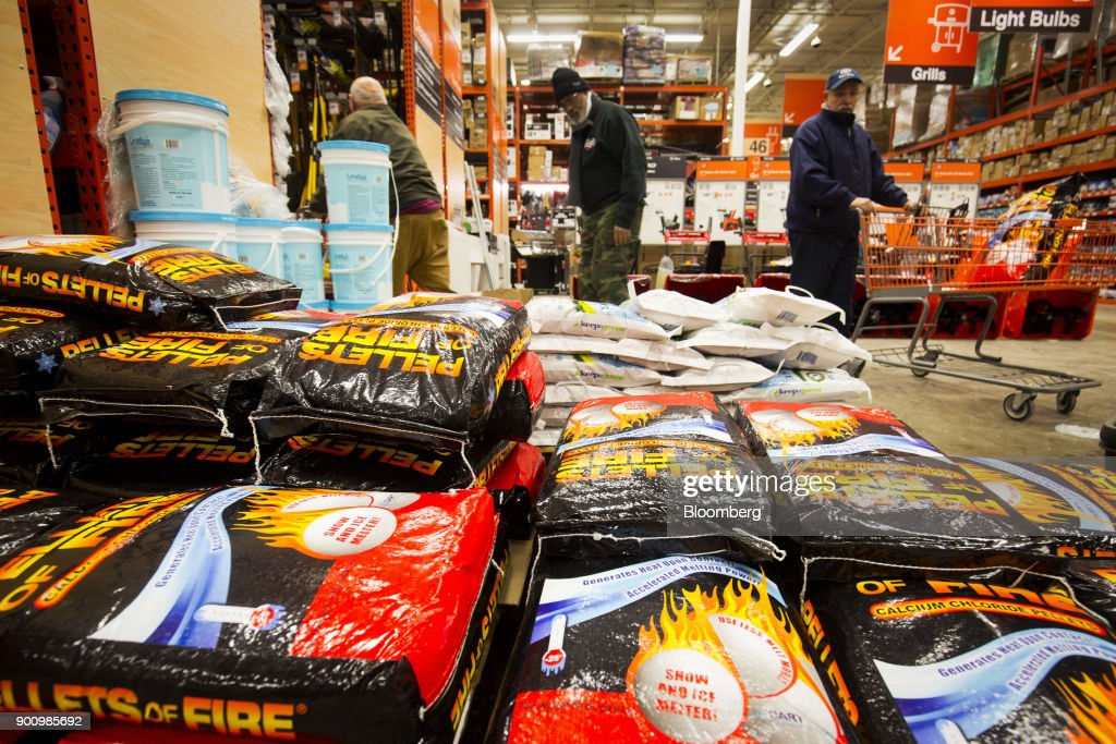 Customers browse packages of ice melter at a Home Depot Inc. store in Boston, Massachusetts, U.S., on Wednesday, Jan. 3, 2018. The worst winter storm of the season has already knocked out power and canceled more than 1,600 flights. Next it threatens to bring more snow, ice and cold from Florida to Nova Scotia, including New York and Boston. Photographer: Adam Glanzman/Bloomberg via Getty Images