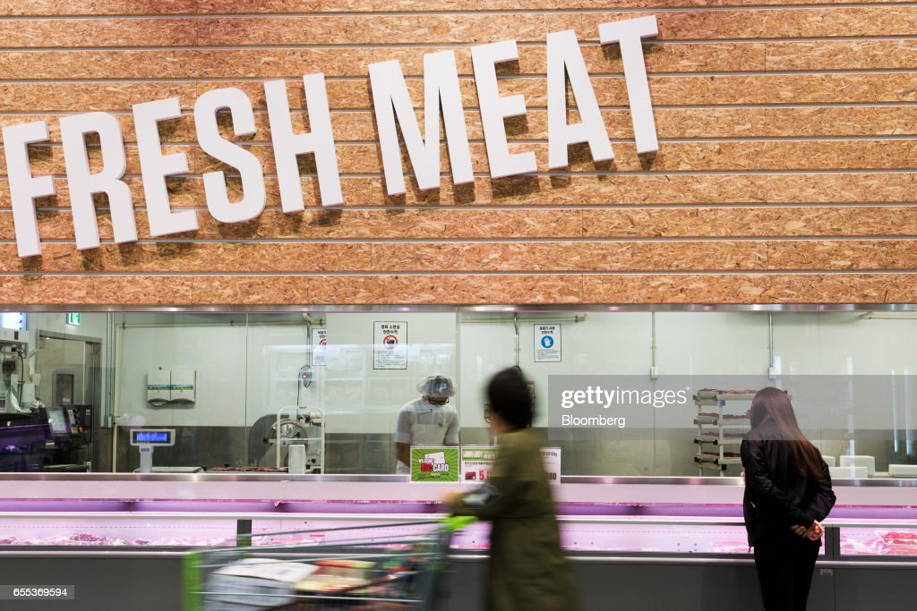 Customers browse packed meat in a chiller at an E-Mart Inc. Traders store in the Starfield Hanam shopping complex, operated by Shinsegae Co., in Hanam, Gyeonggi, South Korea, on Wednesday, March 15, 2017. South Korea is scheduled to release consumer confidence figures on March 24. Photographer: SeongJoon Cho/Bloomberg via Getty Images