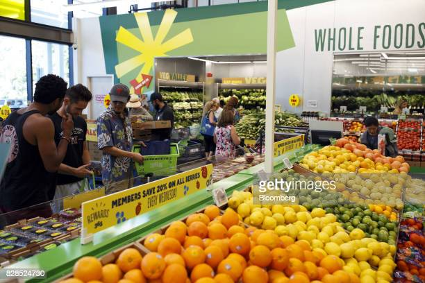 Customers browse produce during the grand opening of a Whole Foods Market 365 location in Santa Monica California US on Wednesday Aug 9 2017 The...
