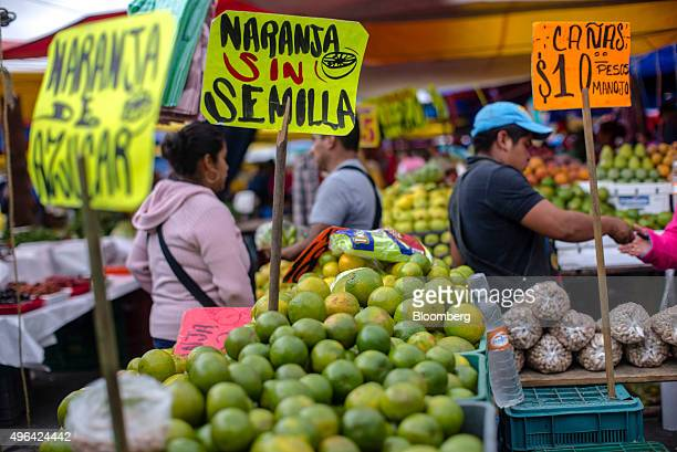 Customers browse produce stalls at a marketplace in Tepeyanco Tlaxcala Mexico on Saturday Oct 31 2015 Mexican consumer prices rose in line with...