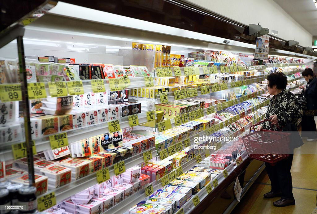 Customers browse refrigerated products at a supermarket in Tokyo, Japan, on Tuesday, April 9, 2013. After Bank of Japan Governor Haruhiko Kuroda's first policy meeting as governor on April 4, the central bank set a two-year horizon for the 2 percent annual price-increase target that it adopted in January at the urging of Prime Minister Shinzo Abe. Photographer: Tomohiro Ohsumi/Bloomberg via Getty Images