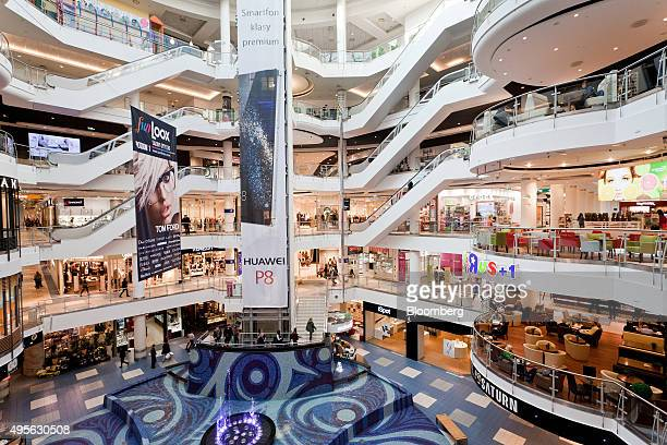 Customers browse retail floors at the Blue City shopping mall in Warsaw Poland on Wednesday Nov 4 2015 Poland left its benchmark interest rate at a...
