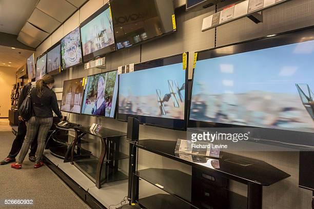 Customers browse Samsung 4K Ultra High Definition televisions in a Best Buy electronics store in New York The cost of 4K televisions has come down...